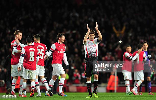 Liverpool's English midfielder Steven Gerrard thanks the fans after the English FA Cup fifth round football match between Arsenal and Liverpool at...