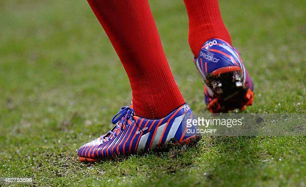 Liverpool's English midfielder Steven Gerrard's boots featuring the number 700 are pictured as he warms up before the start of the FA Cup fourth...