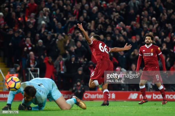 Liverpool's English midfielder Trent AlexanderArnold celebrates scoring their third goal during the English Premier League football match between...