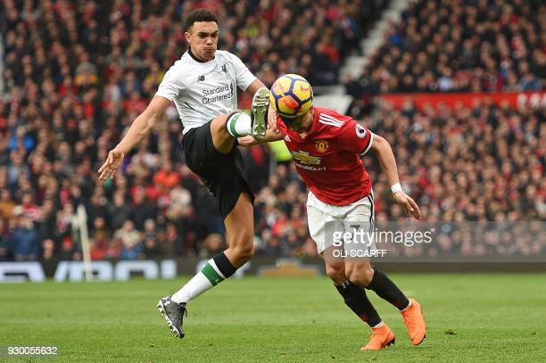 TOPSHOT Liverpool's English midfielder Trent AlexanderArnold concedes a free kick as he challenges Manchester United's Chilean striker Alexis Sanchez...