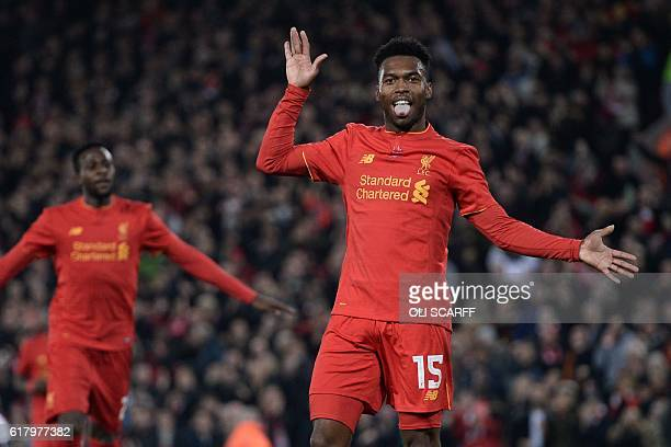 Liverpool's English striker Daniel Sturridge celebrates after scoring their second goal during the EFL Cup fourth round match between Liverpool and...