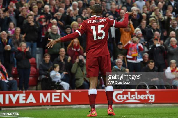 Liverpool's English striker Daniel Sturridge celebrates after scoring the opening goal of the English Premier League football match between Liverpool...