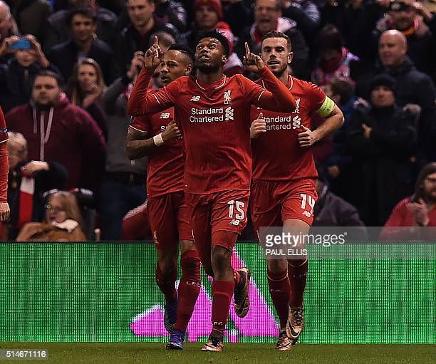 Liverpool's English striker Daniel Sturridge celebrates scoring his team's first goal from the peanlrty spot during the UEFA Europa League round of...
