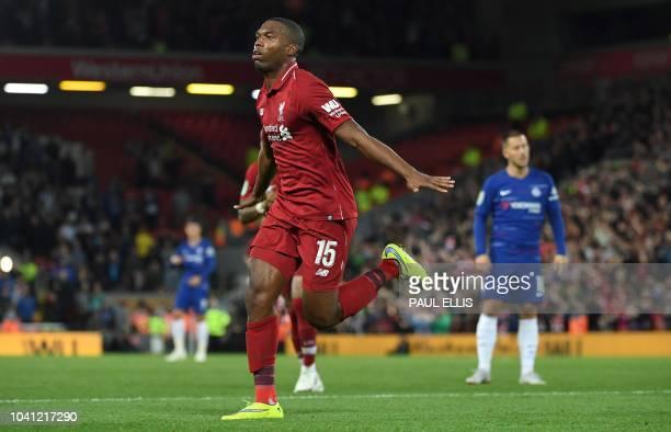 Liverpool's English striker Daniel Sturridge celebrates scoring the opening goal during the English League Cup third round football match between...