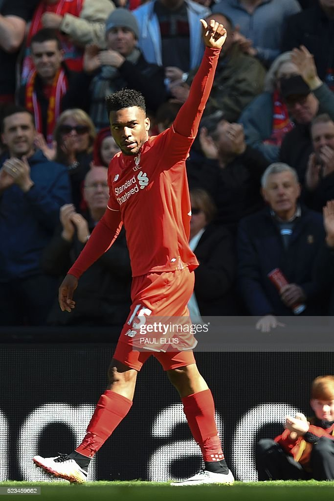 Liverpool's English striker Daniel Sturridge celebrates scoring the opening goal during the English Premier League football match between Liverpool and Newcastle United at Anfield in Liverpool, north west England on April 23, 2016. / AFP / PAUL ELLIS / RESTRICTED TO EDITORIAL USE. No use with unauthorized audio, video, data, fixture lists, club/league logos or 'live' services. Online in-match use limited to 75 images, no video emulation. No use in betting, games or single club/league/player publications. /