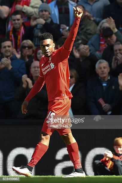 Liverpool's English striker Daniel Sturridge celebrates scoring the opening goal during the English Premier League football match between Liverpool...