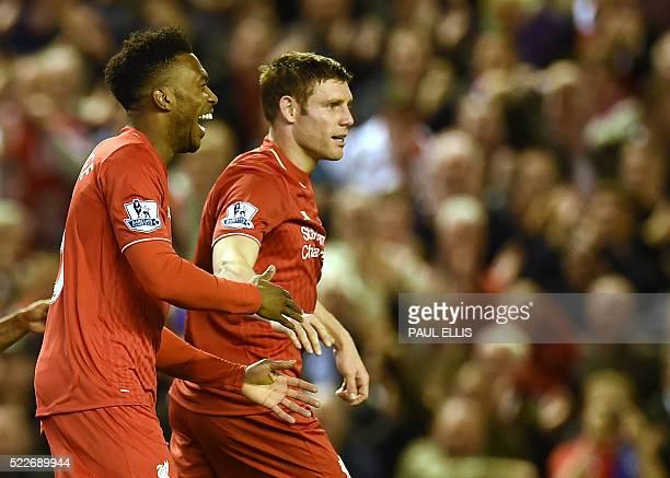 Liverpool's English striker Daniel Sturridge celebrates with Liverpool's English midfielder James Milner after scoring during the English Premier...
