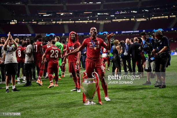 Liverpool's English striker Daniel Sturridge celebrates with the trophy after winning the UEFA Champions League final football match between...
