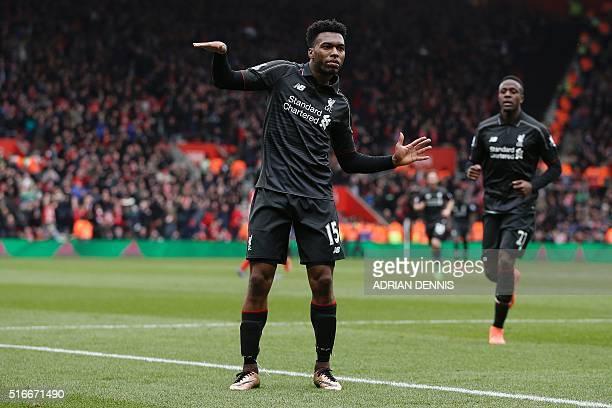 Liverpool's English striker Daniel Sturridge dances aas he celebrates scoring his team's second goal during the English Premier League football match...
