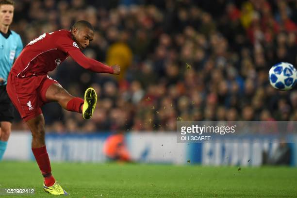 Liverpool's English striker Daniel Sturridge has an unsuccessful shot during the UEFA Champions League group C football match between Liverpool and...