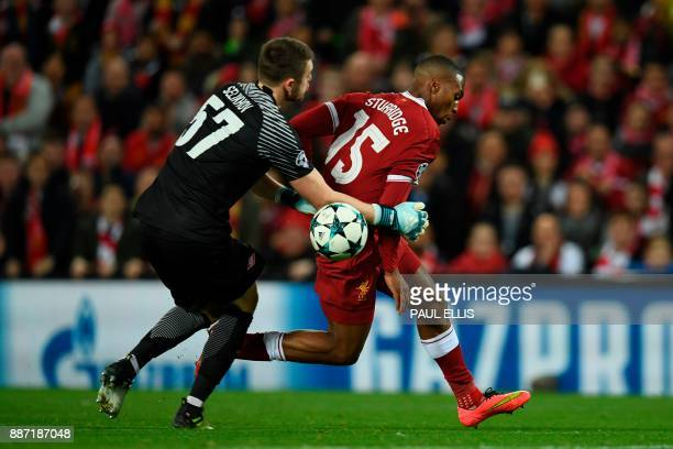 Liverpool's English striker Daniel Sturridge is challenged by Spartak Moscow's Russian goalkeeper Aleksandr Selikhov during the UEFA Champions League...