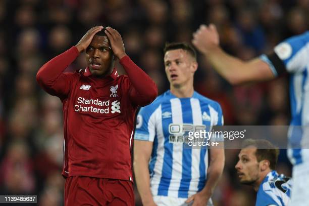 Liverpool's English striker Daniel Sturridge reacts to a missed shot during the English Premier League football match between Liverpool and...