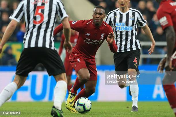 Liverpool's English striker Daniel Sturridge runs with the ball during the English Premier League football match between Newcastle United and...