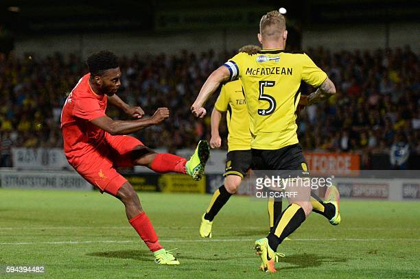 Liverpool's English striker Daniel Sturridge scores Liverpool's fifth goal during the English League Cup second round football match between Burton...