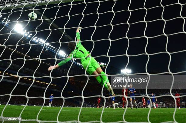 Liverpool's English striker Daniel Sturridge scores the team's first goal past Chelsea's Spanish goalkeeper Kepa Arrizabalaga during the English...