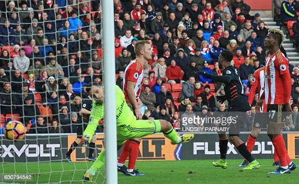 Liverpool's English striker Daniel Sturridge turns to celebrate after his header beats Sunderland's Italian goalkeeper Vito Mannone to opening the...