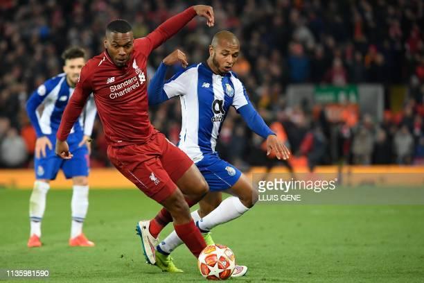 Liverpool's English striker Daniel Sturridge vies for the ball with Porto's Algerian midfielder Yacine Brahimi during the UEFA Champions League...