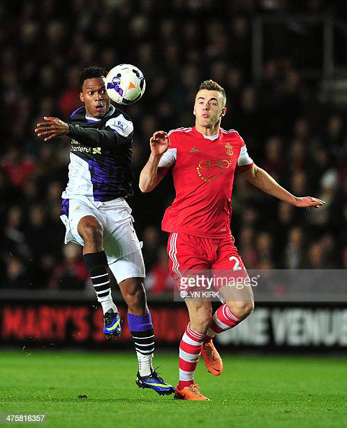 Liverpool's English striker Daniel Sturridge vies for the ball with Southampton's English defender Calum Chambers during the English Premier League...