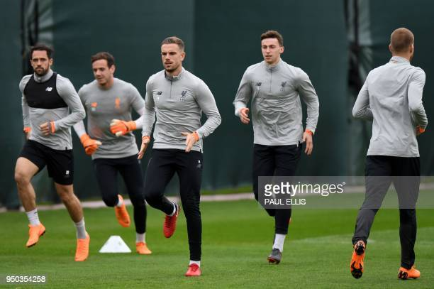 Liverpool's English striker Danny Ings Liverpool's Welsh goalkeeper Danny Ward and Liverpool's English midfielder Jordan Henderson attends a training...
