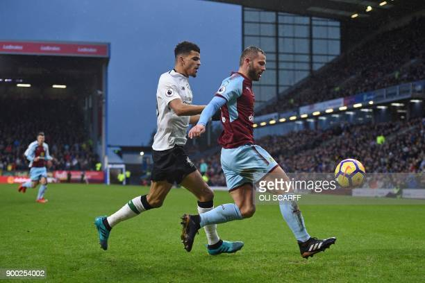Liverpool's English striker Dominic Solanke vies with Burnley's Englishborn Scottish defender Phil Bardsley during the English Premier League...