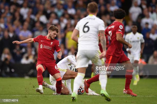 Liverpool's English striker Harvey Elliott gets tackled and suffers a serious leg injury during a tackle by Leeds United's Dutch defender Pascal...
