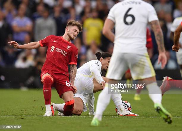 Liverpool's English striker Harvey Elliott suffers a serious leg injury following a tackle by Leeds United's Dutch defender Pascal Struijk during the...