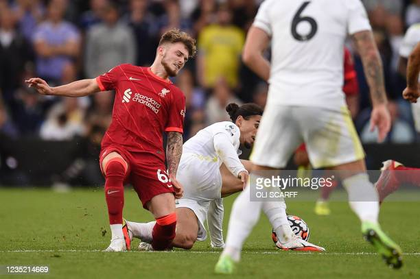 Liverpool's English striker Harvey Elliott suffers a serious leg injury during a tackle by Leeds United's Dutch defender Pascal Struijk during the...
