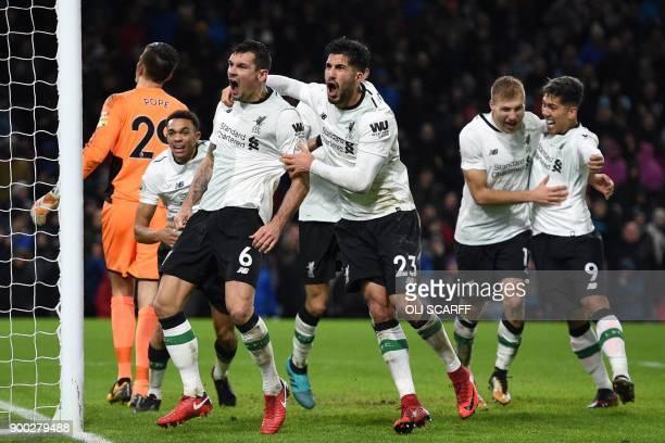 Liverpool's Estonian defender Ragnar Klavan celebrates with teammates after scoring their second goal during the English Premier League football...