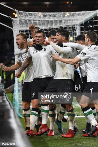 Liverpool's Estonian defender Ragnar Klavan celebrates with teammates after scoring their second goal during the English Premier League football...