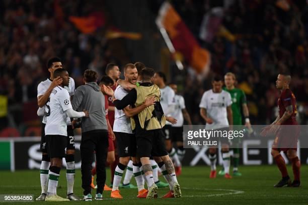 Liverpool's Estonian defender Ragnar Klavan celebrates with teammates after winning the UEFA Champions League semifinal second leg football match...