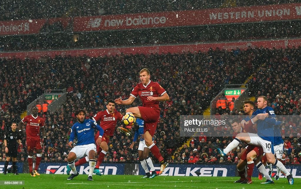 TOPSHOT - Liverpool's Estonian defender Ragnar Klavan (C) jumps to defend a corner during the English Premier League football match between Liverpool and Everton at Anfield in Liverpool, north west England on December 10, 2017. / AFP PHOTO / Paul ELLIS / RESTRICTED TO EDITORIAL USE. No use with unauthorized audio, video, data, fixture lists, club/league logos or 'live' services. Online in-match use limited to 75 images, no video emulation. No use in betting, games or single club/league/player publications. /