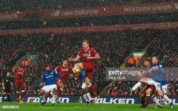 TOPSHOT Liverpool's Estonian defender Ragnar Klavan jumps to defend a corner during the English Premier League football match between Liverpool and...