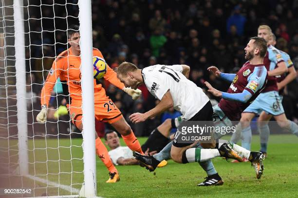 Liverpool's Estonian defender Ragnar Klavan stoops to head home their second goal during the English Premier League football match between Burnley...