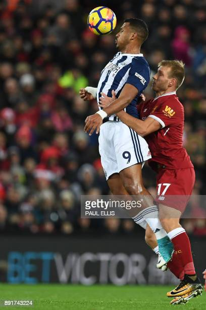 Liverpool's Estonian defender Ragnar Klavan vies with West Bromwich Albion's Venezuelan striker Salomon Rondon during the English Premier League...