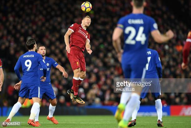 TOPSHOT Liverpool's Estonian defender Ragnar Klavan wins a header during the English Premier League football match between Liverpool and Chelsea at...
