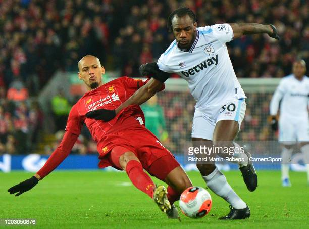 Liverpool's Fabinho vies for possession with West Ham United's Michail Antonio during the Premier League match between Liverpool FC and West Ham...