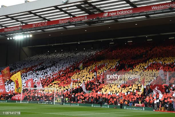 Liverpool's fans hold up a mosaic making out the number 96 as they observe a minute's silence for the 30th Anniversary of the the Hillsborough...