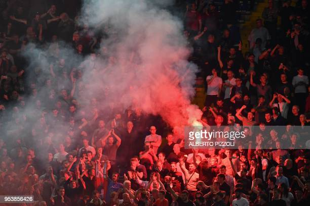 Liverpool's fans light a flare in the grandstand before the UEFA Champions League semifinal second leg football match AS Roma vs Liverpool FC at the...