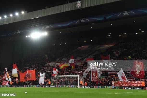 Liverpool's fans wave flags in the crowd ahead of the UEFA Champions League Group E football match between Liverpool and NK Maribor at Anfield in...