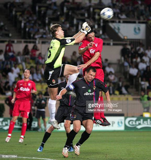 Liverpool's Fernando Morientes battles with CSKA Moscow goalkeeper Igor Akinfeev and Sergey Berezutskiy for the ball during the UEFA Super Cup match...