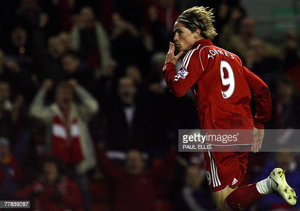 Liverpool's Fernando Torres celebrates scoring past Fulham goalkeeper Antti Niemi during their English Premiership football match at Anfield...