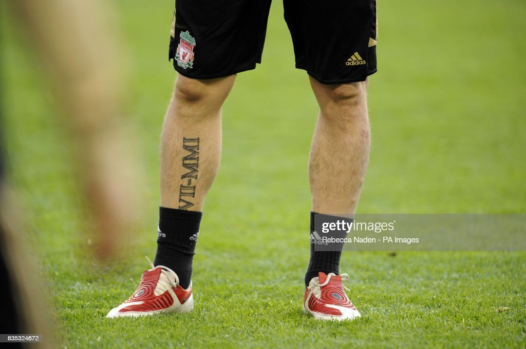 Liverpool's Fernando Torres displays a tattoo during a ...