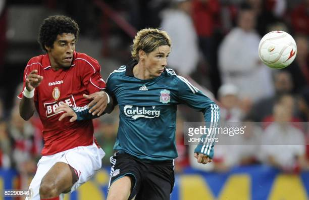 Liverpool's Fernando Torres fights for the ball with Standard de Liege's Dante Bonfim Costa during their UEFA Champions League third qualifying round...