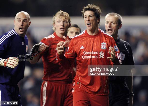 Liverpool's Fernando Torres Pepe Reina and Dirk Kuyt argue with referee Martin Atkinson after he awarded a penalty to Tottenham Hotspur during their...