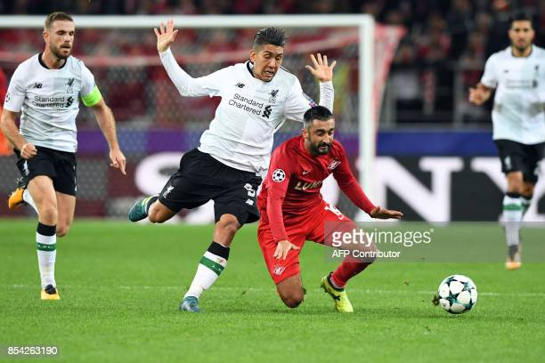 Liverpool's forward from Brazil Roberto Firmino and Spartak Moscow's midfielder from Russia Alexander Samedov vie for the ball during the UEFA...
