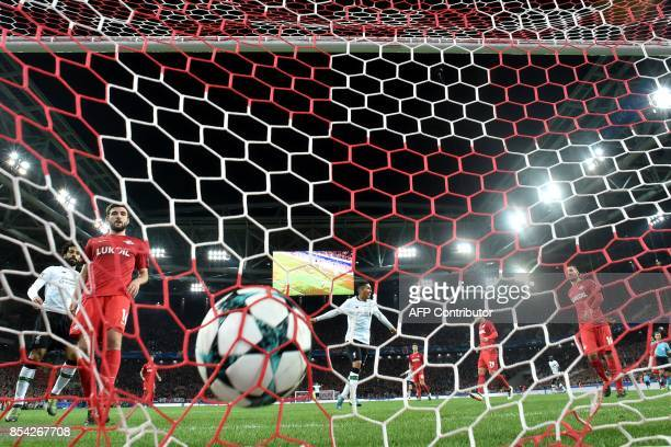 Liverpool's forward from Brazil Roberto Firmino celebrates a goal scored by Liverpool's midfielder from Brazil Philippe Coutinho Correia during the...
