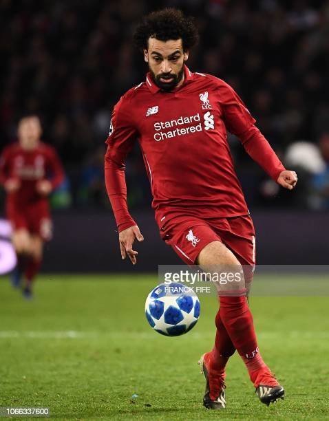 Liverpool's forward Mohamed Salah plays the ball during the UEFA Champions League Group C football match between Paris SaintGermain and Liverpool FC...