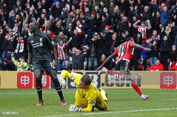 Liverpool's French defender Mamadou Sakho and Liverpool's Belgian goalkeeper Simon Mignolet reacts as Southampton's Senegalese midfielder Sadio Mane...