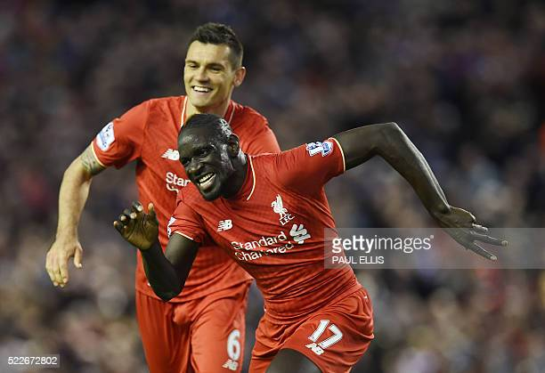Liverpool's French defender Mamadou Sakho celebrates with Liverpool's Croatian defender Dejan Lovren after scoring during the English Premier League...