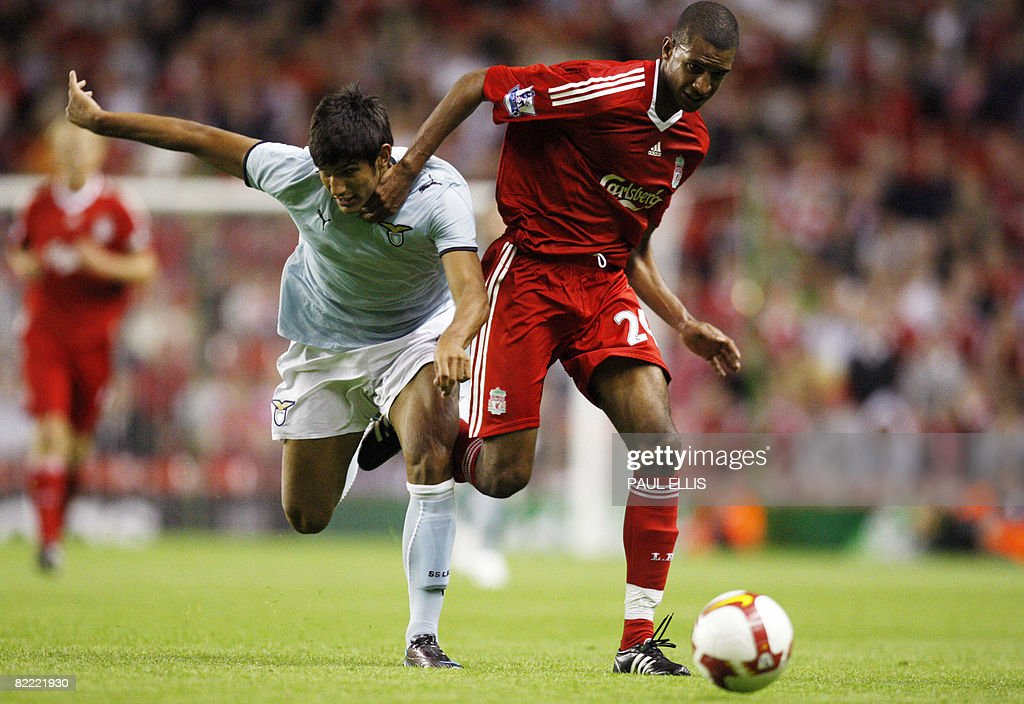 Liverpool's French forward David Ngog (R) is challenged by Lazio's Alessandro Tuia during the pre-season friendly football match at Anfield, Liverpool, north-west England on August 8, 2008.